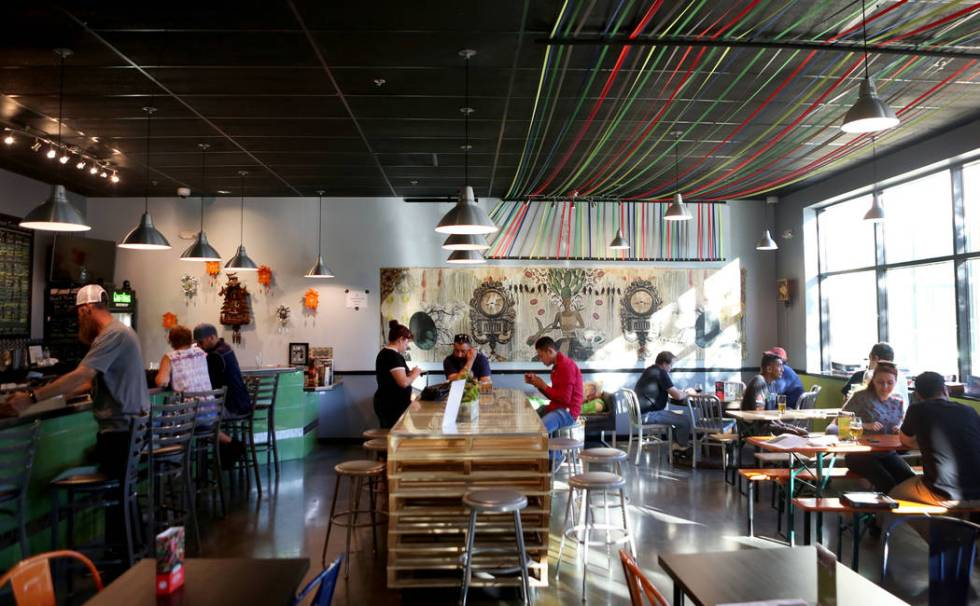 People play games, eat and drink beer at Crafthaus Brewery during the Silver State beer kicks o ...