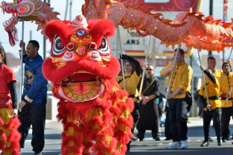 Performers from the Lohan School of Shaolin Kung Fu march in a parade during Chinese New Year c ...