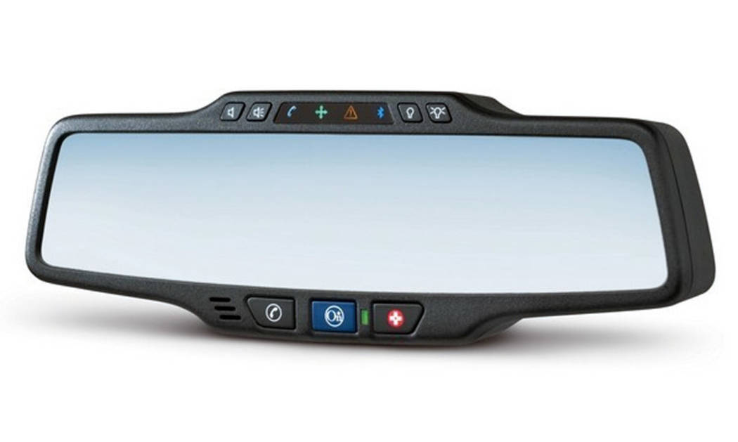 A car's rear-view mirror bears a button for the now-common OnStar roadside guidance and emergen ...