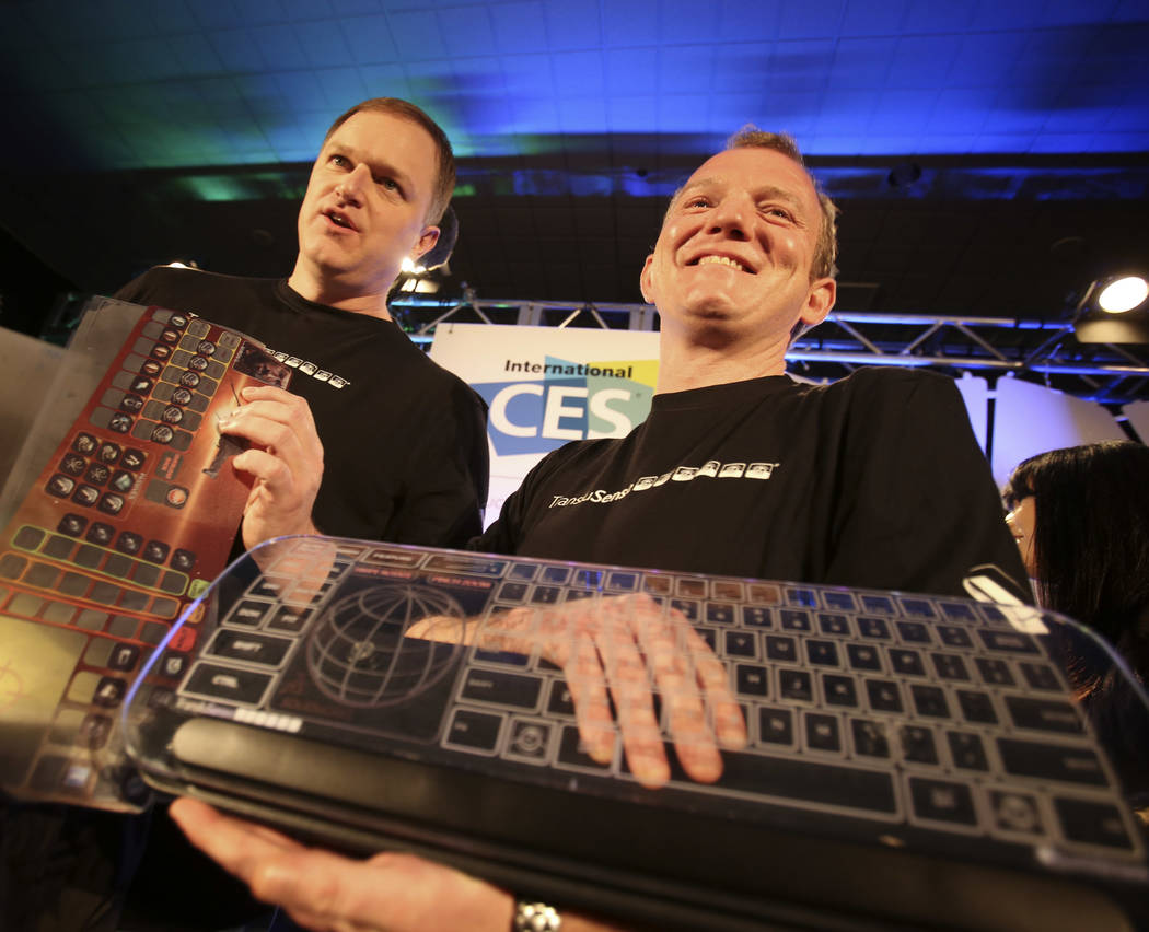 TransluSense executives Jason Giddings, left, and Mark Collins display the Luminae Cleartouch g ...