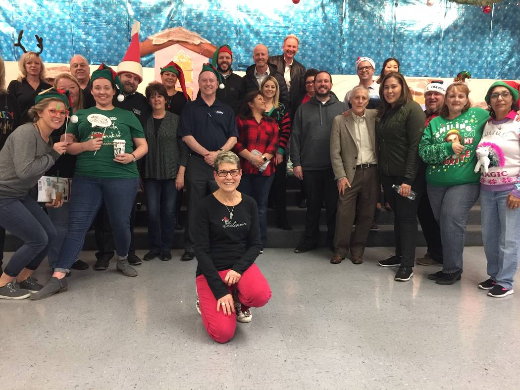 Findlay Automotive Group employees converged on Whitney Elementary School recently to help asse ...