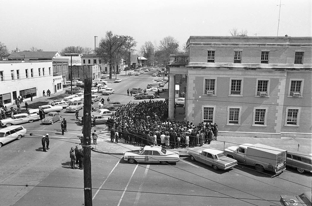 Upward of 500 marchers crowd on the steps and sidewalk in front of Selma, Ala., City Hall and s ...