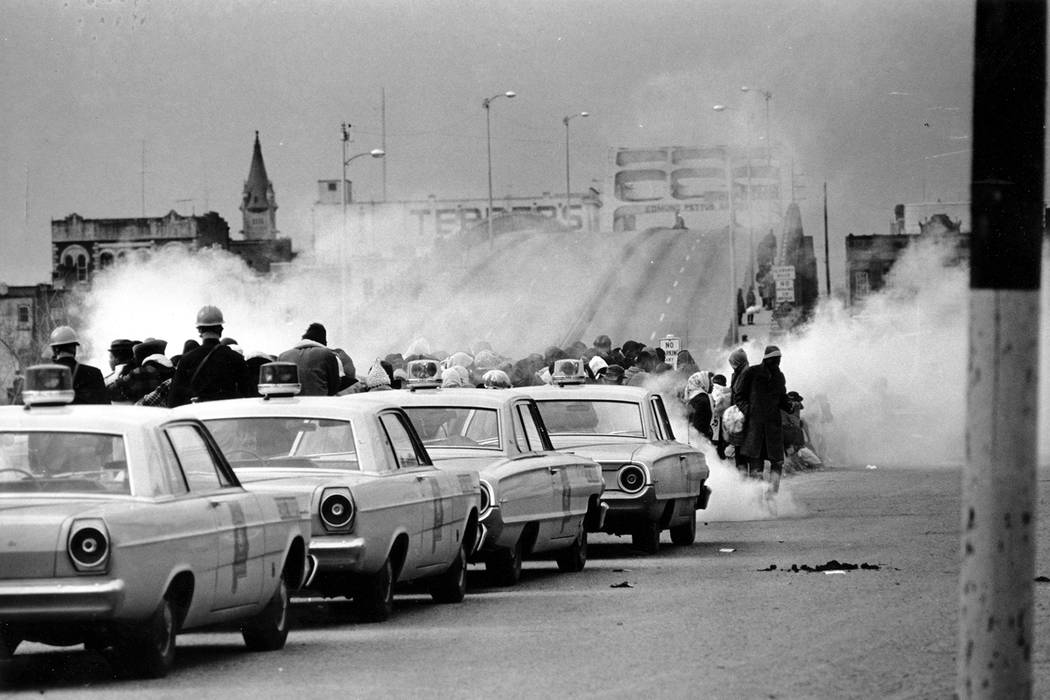 Tear gas fumes fill the air as state troopers, ordered by Gov. George Wallace, break up a demon ...