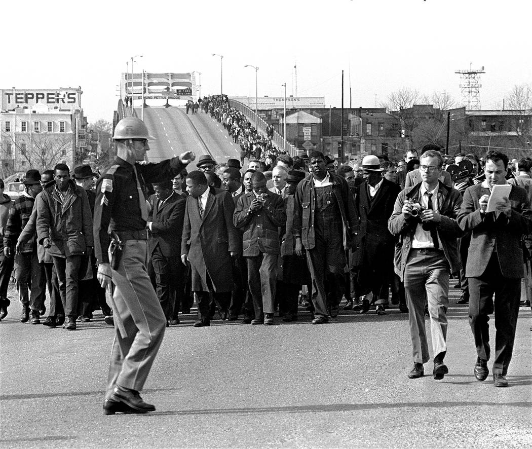 Dr. Martin Luther King, Jr., and his demonstrators stream over an Alabama River bridge at the c ...