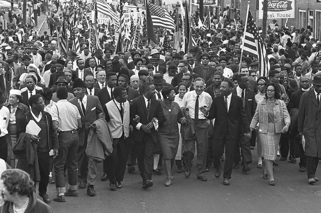 Dr. Martin Luther King, third from right, marchers across the Alabama River on the first of a f ...