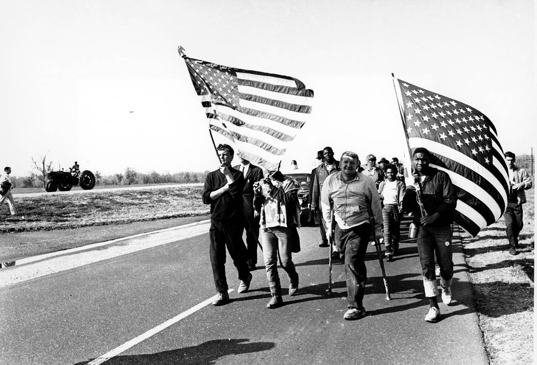 Civil rights marchers carry flags and play the flute as they approach their goal of Montgomery, ...