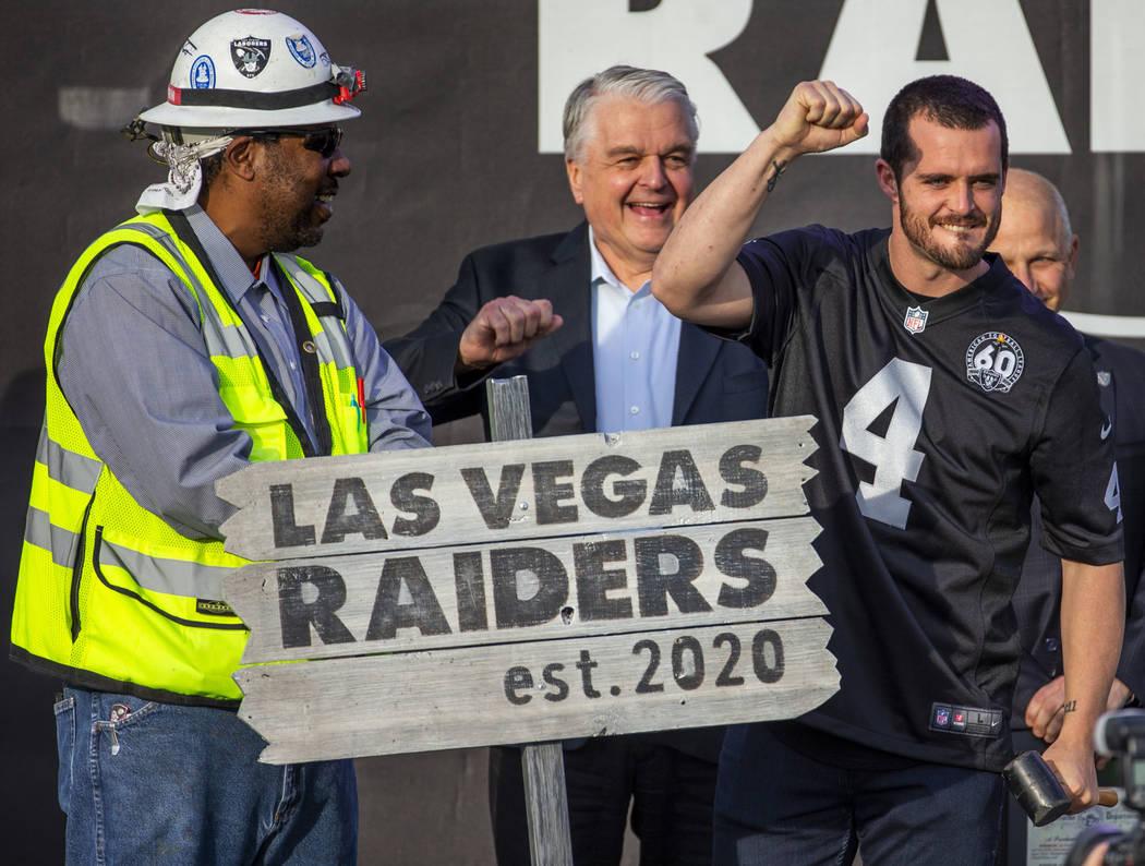 Las Vegas Raiders quarterback Derek Carr (4) pumps a fist to the crowd after hammering a ceremo ...