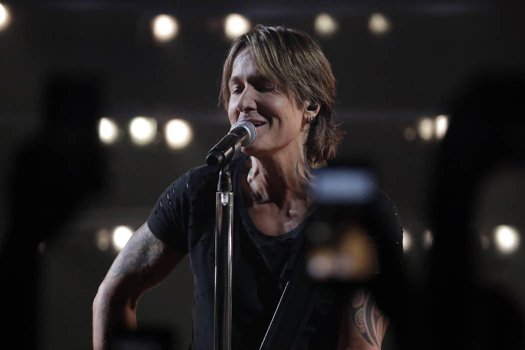 "Keith Urban performs ""We Were"" at the CMT Music Awards on Wednesday, June 5, 2019, at ..."