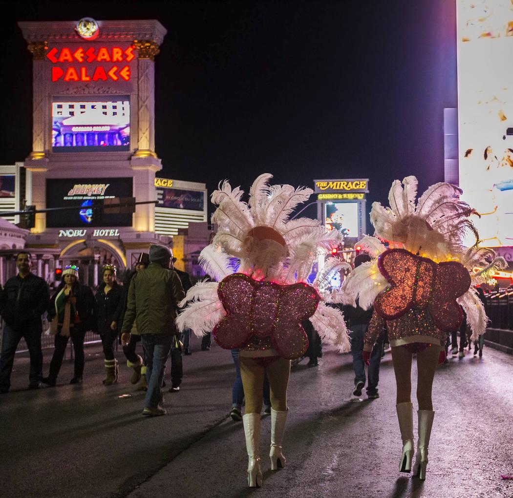 Show girls walk the Strip on Tuesday, Dec. 31, 2019, in Las Vegas. (Benjamin Hager/Las Vegas Re ...