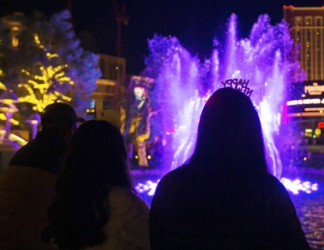 Fatima Peña, from Napa, Calif., enjoys the fountains outside Wynn Las Vegas on the Strip o ...