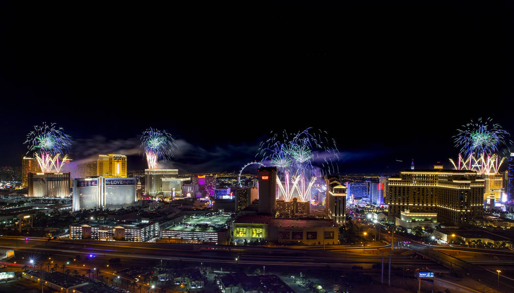 Fireworks for New Year's Eve erupt over the Strip as viewed from the VooDoo Rooftop Nightclub & ...