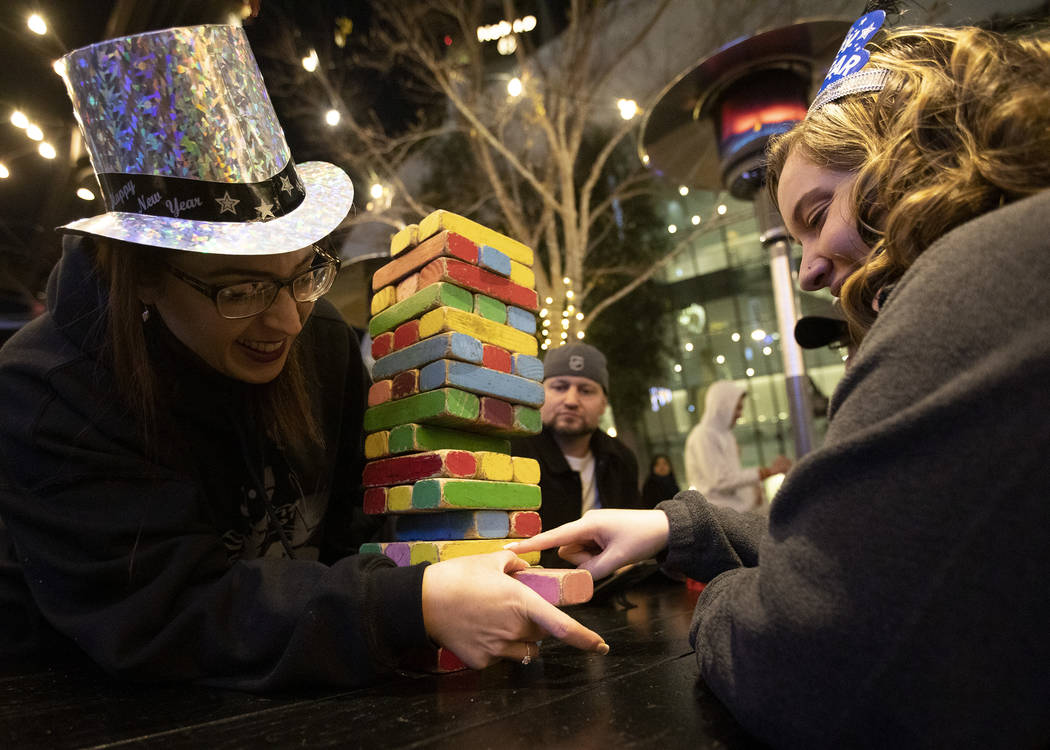 Jennifer Simpson, left, of Las Vegas, and her sister-in-law Megan Simpson, right, of Illinois, ...
