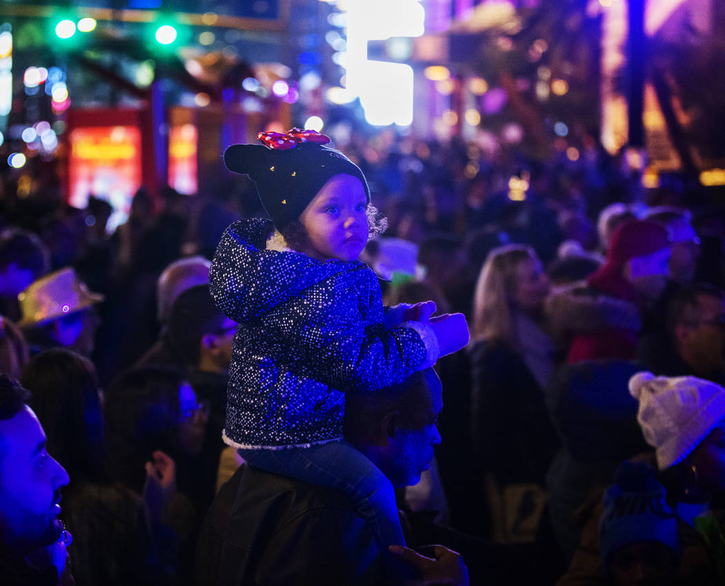 Sage Lewis, 3, from Las Vegas, watches performers on the Strip on Tuesday, Dec. 31, 2019, in La ...