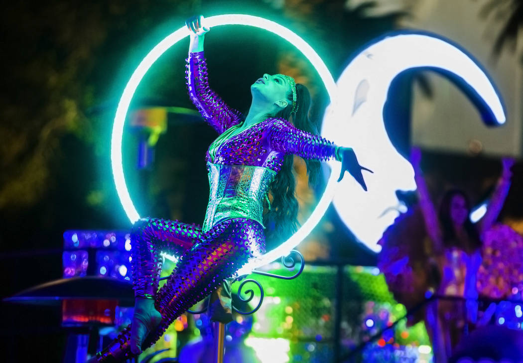 Performers entertain the crowd on the Strip on Tuesday, Dec. 31, 2019, in Las Vegas. (Benjamin ...
