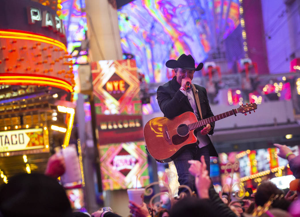 Tony Marques performs as New Year's Eve revelers gather at the Fremont Street Experience in dow ...
