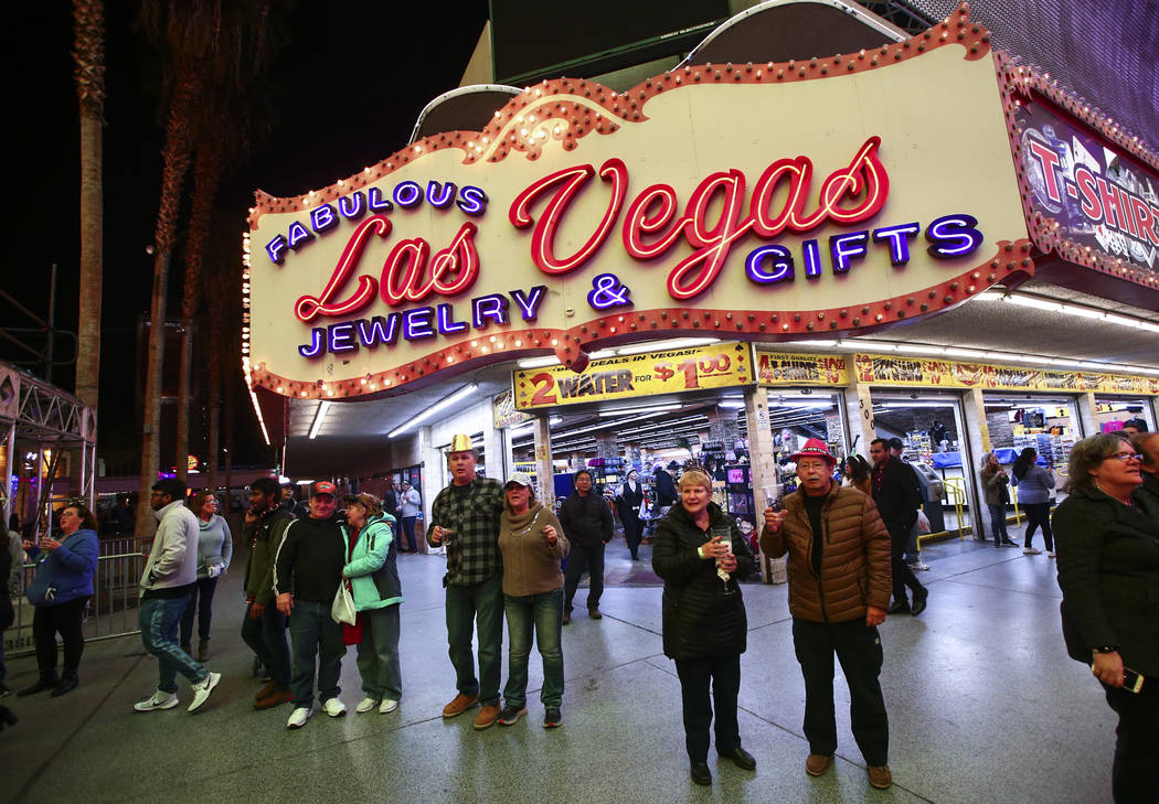New Year's Eve revelers gather at the Fremont Street Experience in downtown Las Vegas on Tuesda ...