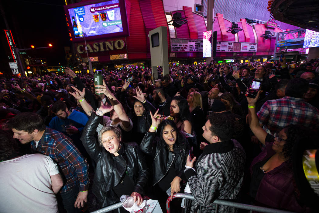Revelers celebrate during a New Year's party at the Fremont Street Experience in downtown Las V ...