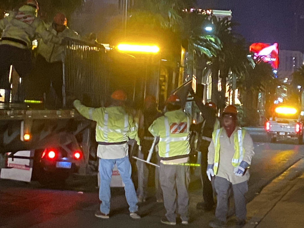 To clear the Strip streets of about 12 to 15 tons of debris, they move from Mandalay Bay north ...