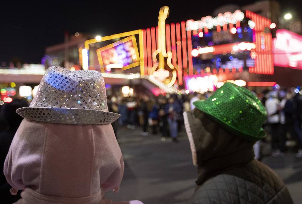 Some were bundled up to see the fireworks on the Las Vegas Strip on Tuesday, Dec. 31, 2019, in ...