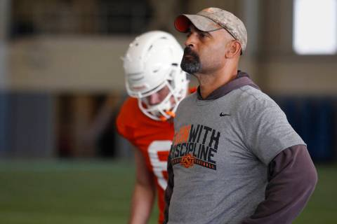Oklahoma State's Kasey Dunn, associate head coach/receivers coach, is staying at OSU. (AP Photo ...