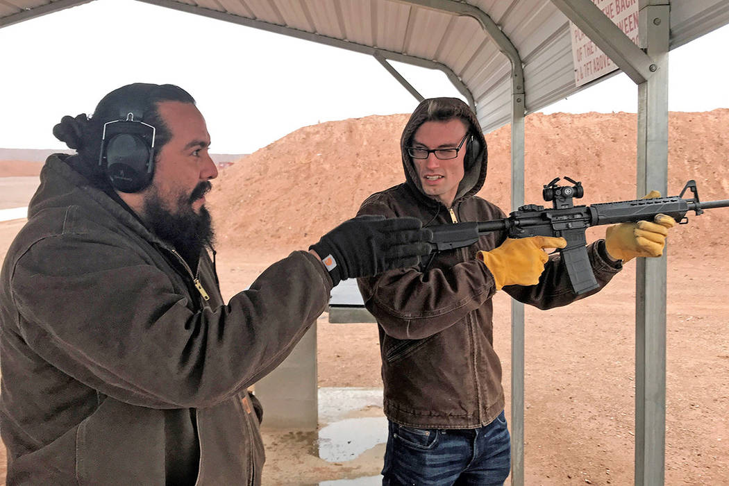 Chad Forsyth instructs Dallin Nielsen how to shoot a modern sporting rifle with the aid of a re ...