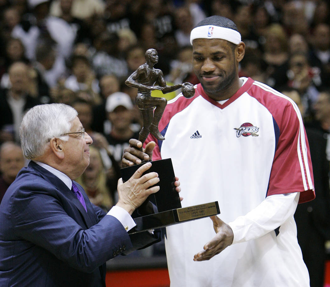NBA commissioner David Stern, left, presents Cleveland Cavaliers' LeBron James with the 2008-20 ...