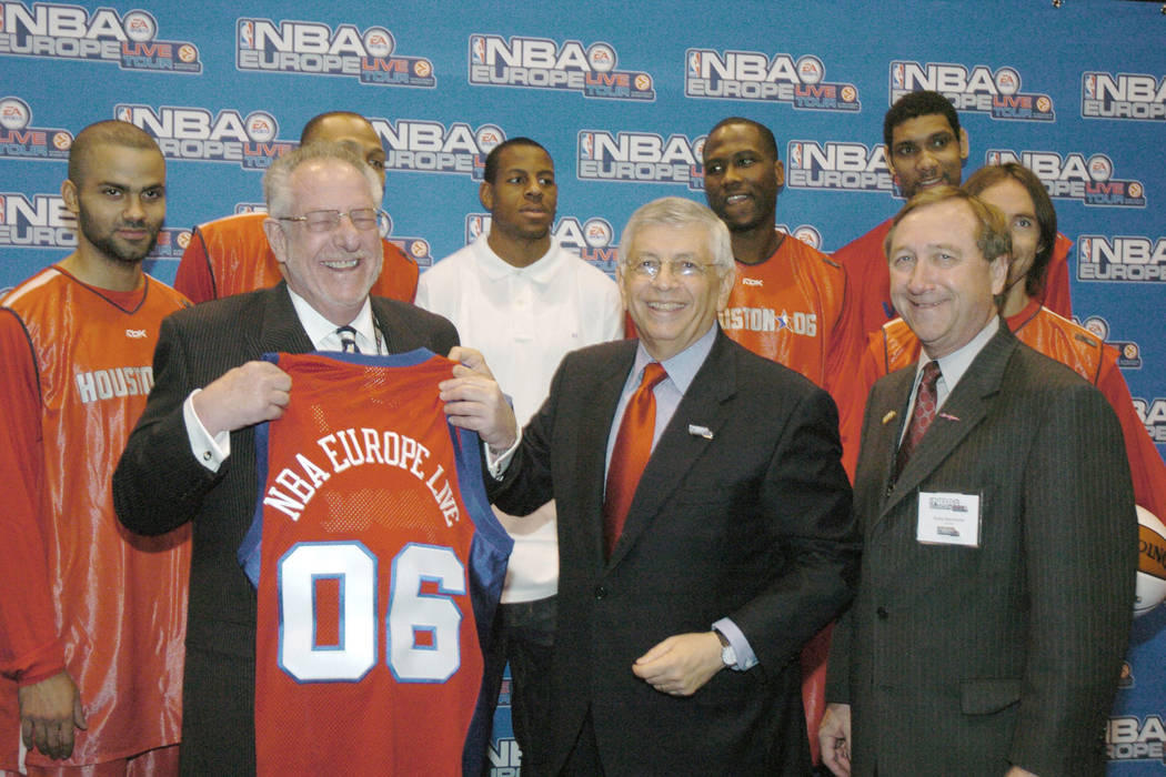 David Stern, center, the Commissioner of the National Basketball Association, smiles as he hand ...