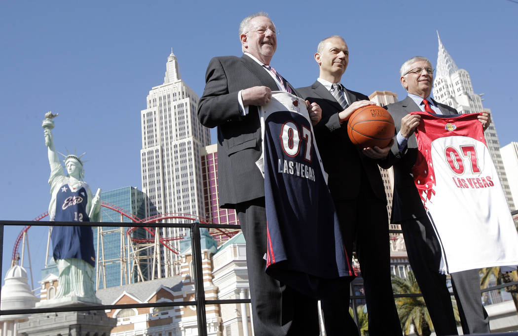 NBA Commissioner David Stern, from right, Erich Stamminger, center, president and CEO of Adidas ...