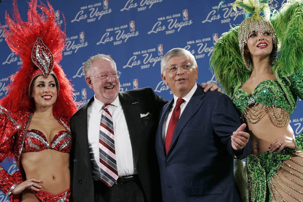 Las Vegas showgirls flank Las Vegas Mayor Oscar Goodman, left, and Commissioner of the National ...