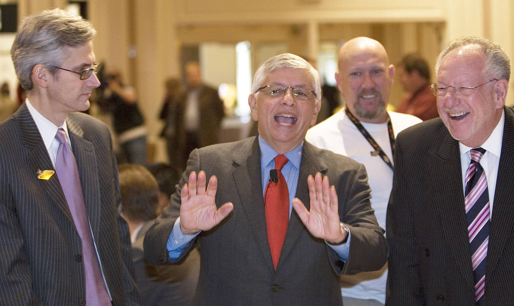 NBA Commissioner David Stern, center, talks to Clark County Commissioner Rory Reid, left, and L ...