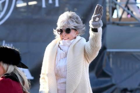 Grand Marshal Rita Moreno waves to the crowd during the 131st Rose Parade in Pasadena, Calif., ...