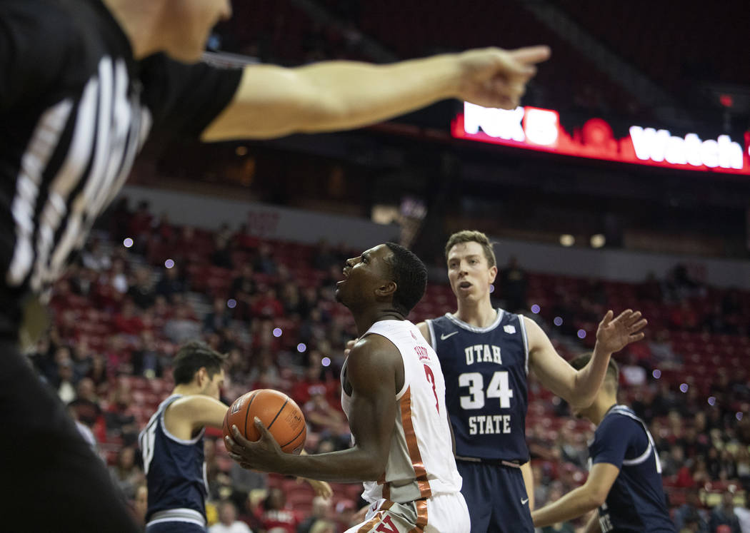 UNLV's guard Amauri Hardy (3) expresses dismay as the referee makes a foul call against UNLV du ...
