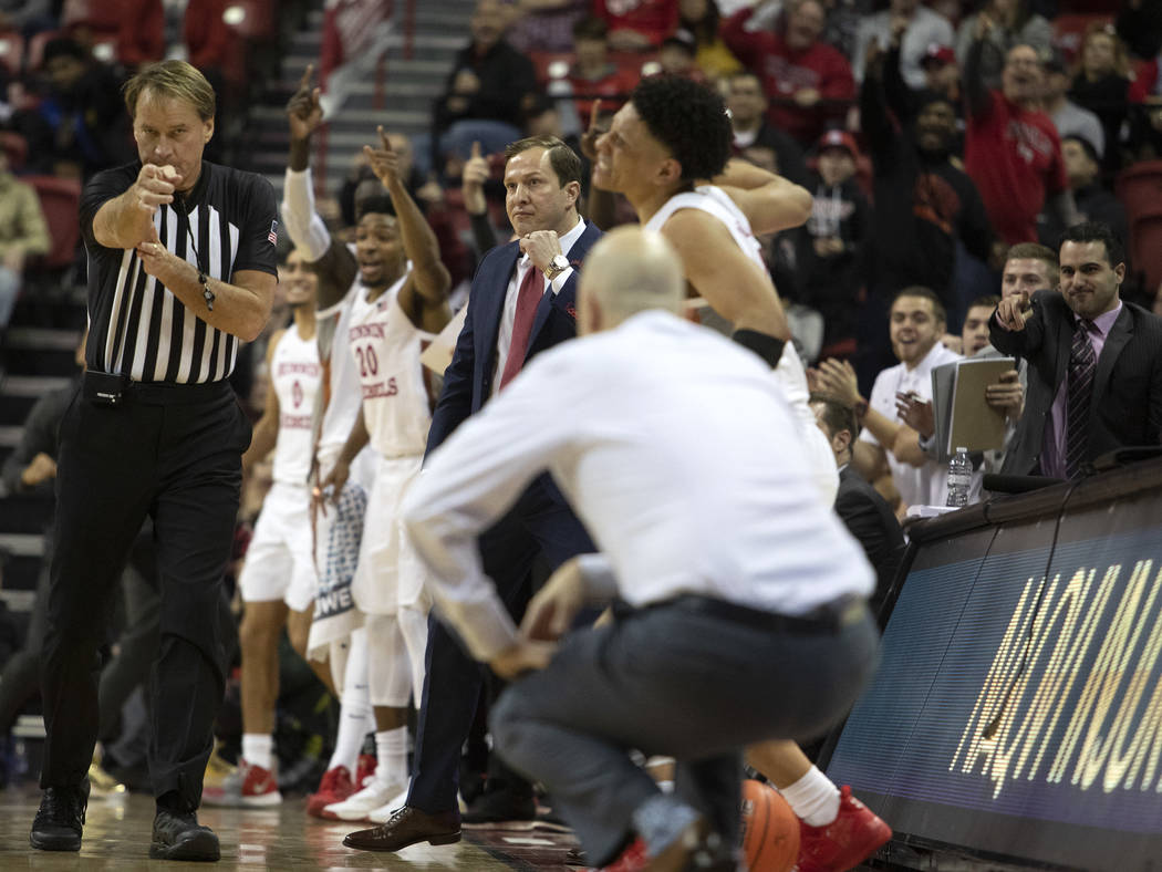 UNLV's basketball team celebrates a call by a referee during the second half of the game agains ...