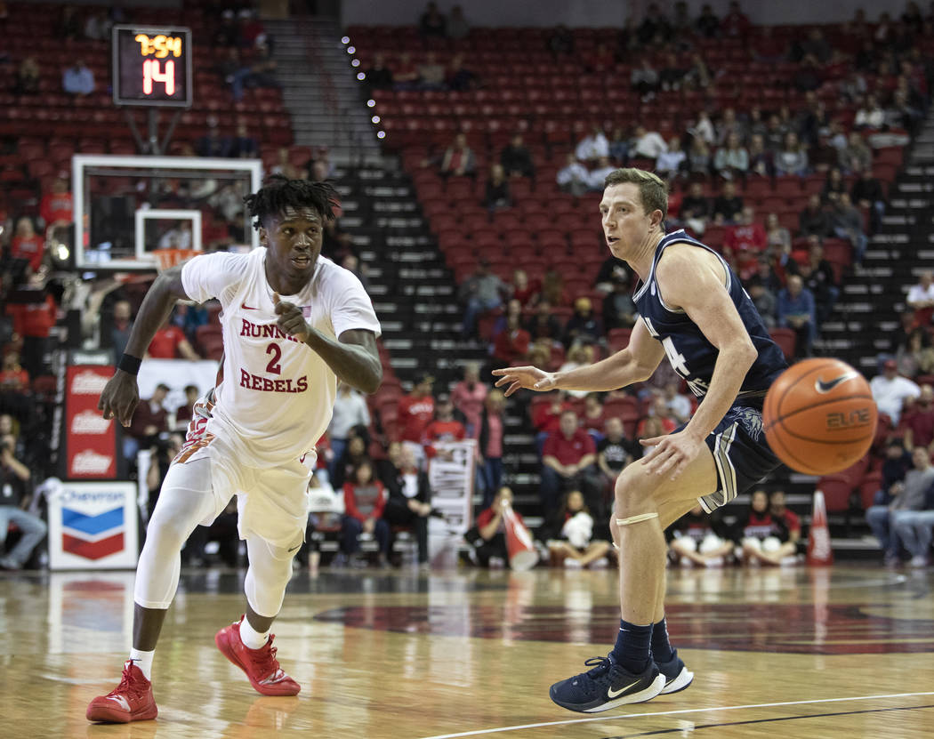 UNLV's forward Donnie Tillman (2) runs after passing the ball as Utah State's forward Justin Be ...