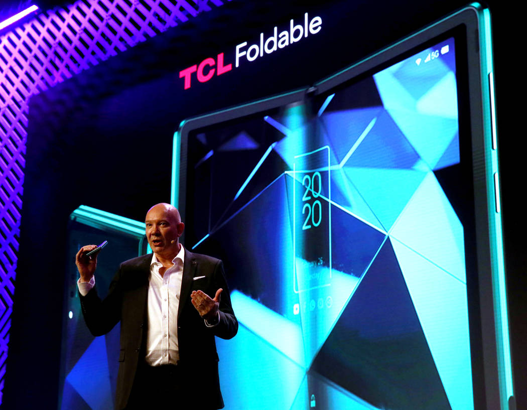 Stefan Streit, general manager of global marketing for TCL Mobile, shows shows a foldable scree ...
