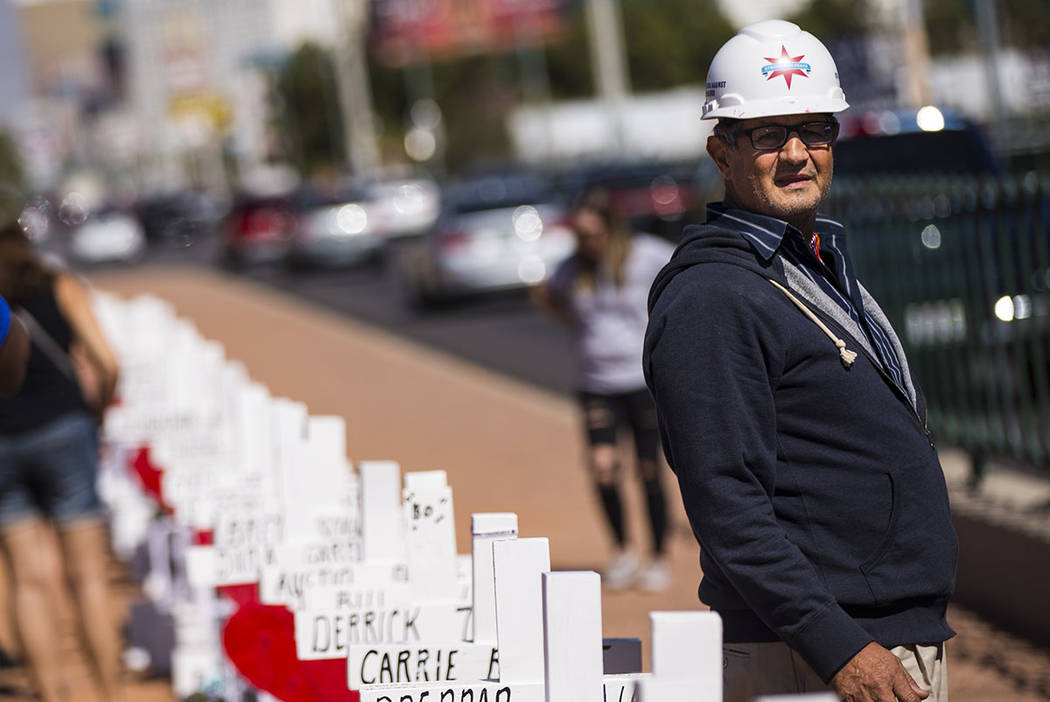 """Greg Zanis stands by the 58 crosses he placed near the """"Welcome to Fabulous Las Vegas&quot ..."""