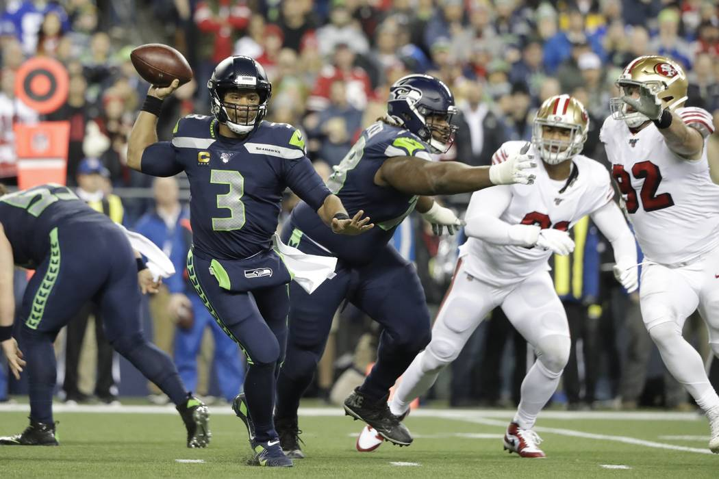 Seattle Seahawks quarterback Russell Wilson in action against the San Francisco 49ers during th ...