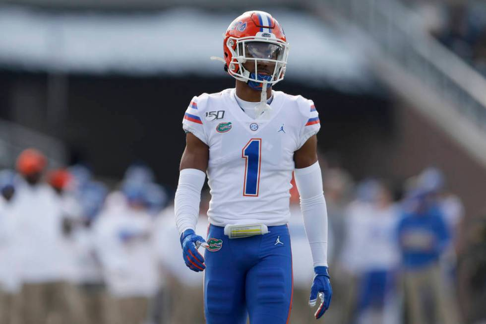 Florida defensive back CJ Henderson takes up his position during the first half of an NCAA coll ...
