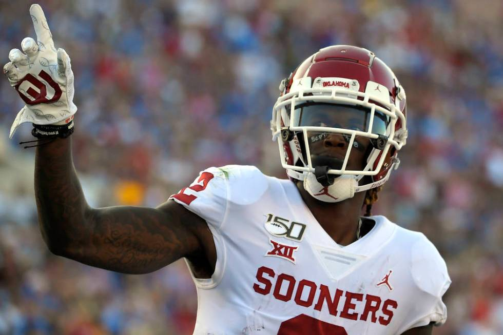 FILE - In this Sept. 14, 2019, file photo, Oklahoma wide receiver CeeDee Lamb celebrates after ...