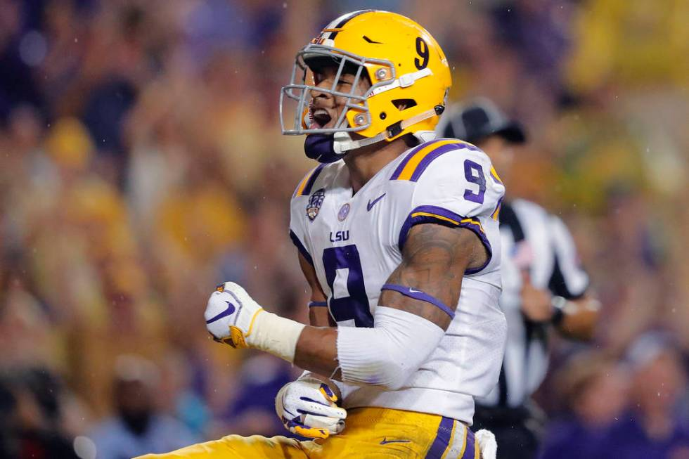 In this Sept. 29, 2018, file photo, LSU safety Grant Delpit (9) celebrates his sack of Mississi ...
