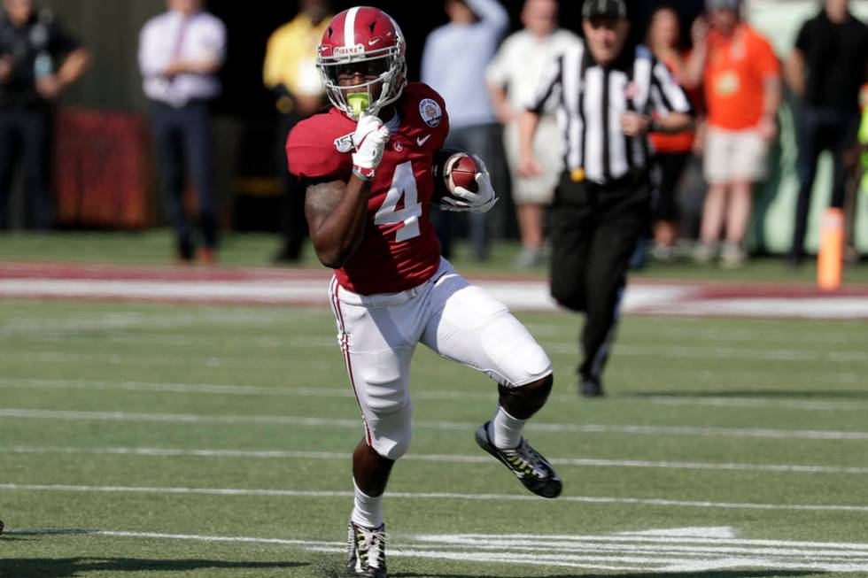 Alabama wide receiver Jerry Jeudy (4) runs after a reception against Michigan during the first ...