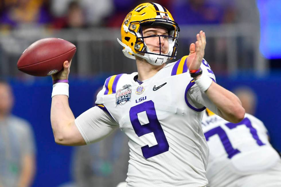 LSU quarterback Joe Burrow (9) works against Oklahoma during the first half of the Peach Bowl N ...