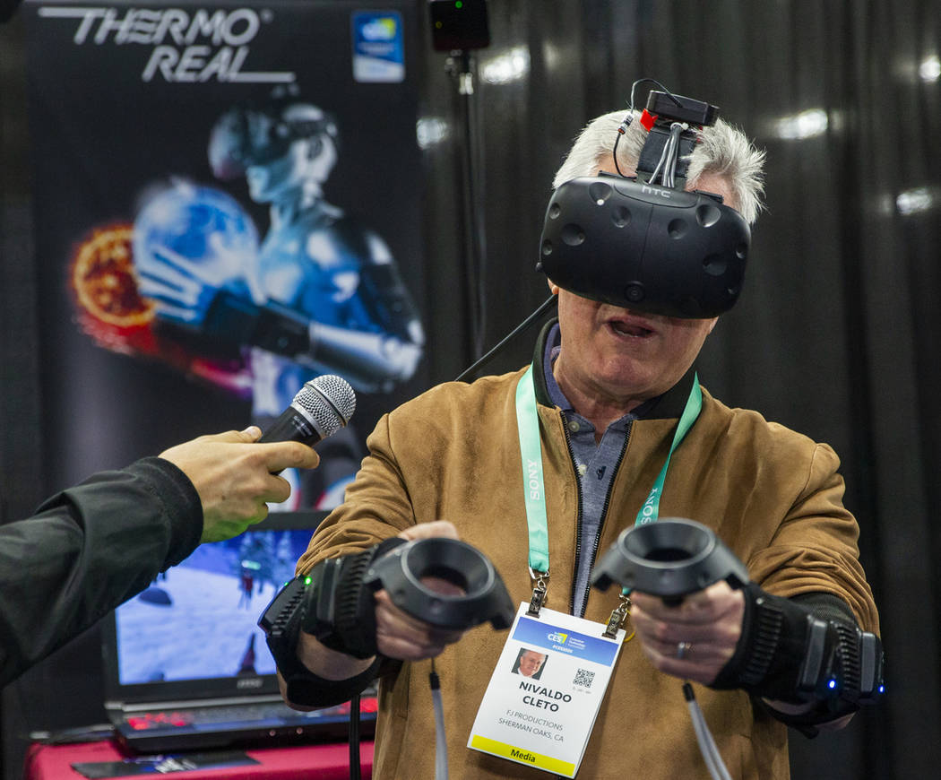 Nivaldo Cleto gives an interview while testing a ThermoReal VR temperature simulation during th ...