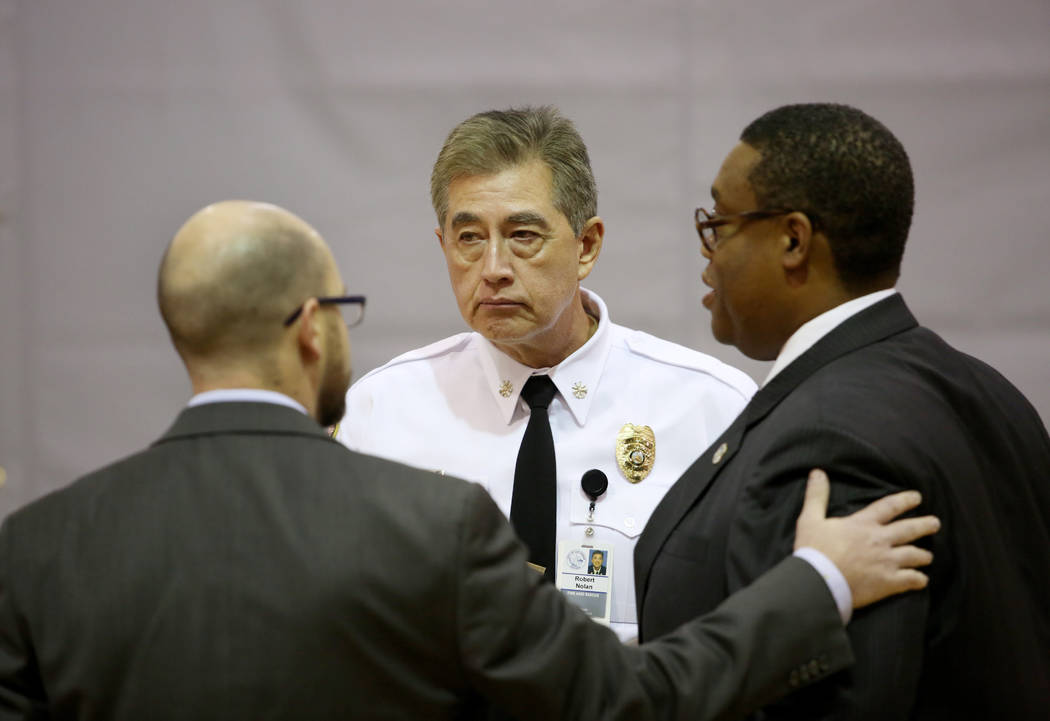 Las Vegas City Ward 1 councilman Brian Knudsen, left, Las Vegas Fire Marshal Robert Nolan, cent ...