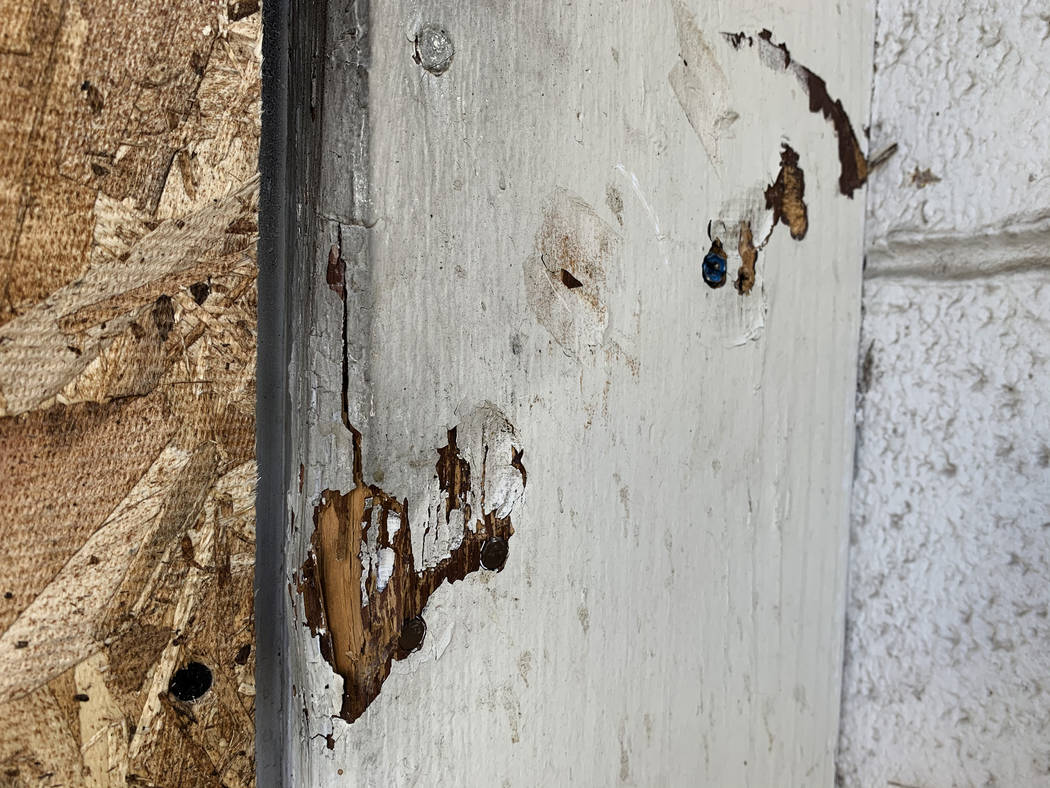 Indentations show where the rear door of the Alpine Motel Apartments was bolted shut, pictured ...