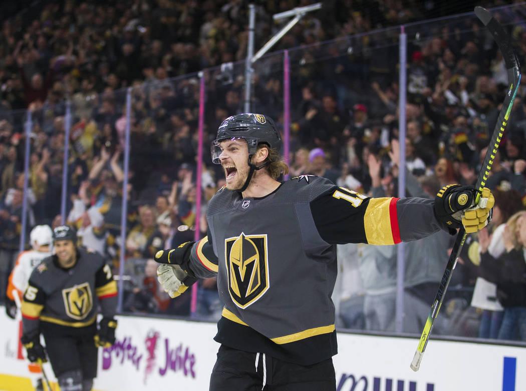 Vegas Golden Knights defenseman Jon Merrill (15) celebrates after scoring a goal in the first p ...