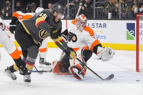 Vegas Golden Knights defenseman Jon Merrill (15) scores a first period goal against Philadelphi ...