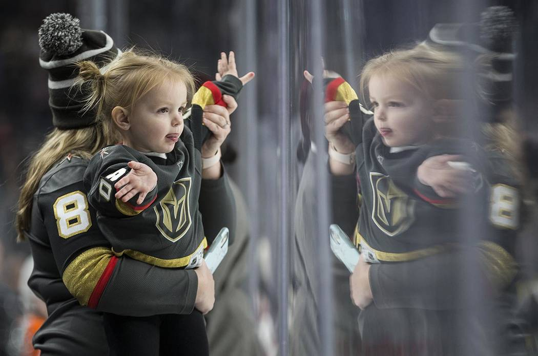 Golden Knights fans cheer for Vegas in the second period of an NHL hockey game against the Phil ...