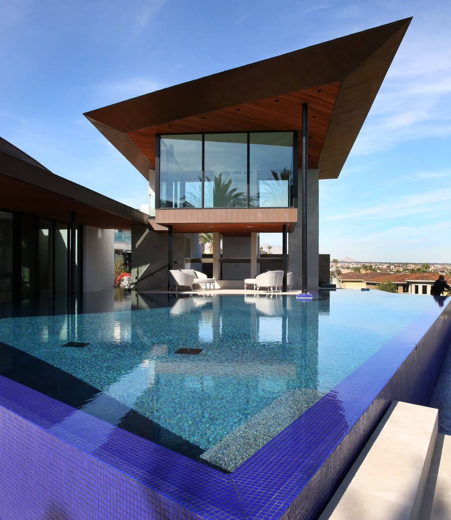 A swimming pool and Zen room are seen at the mansion of Jim Rhodes, a developer, on Friday, Feb ...