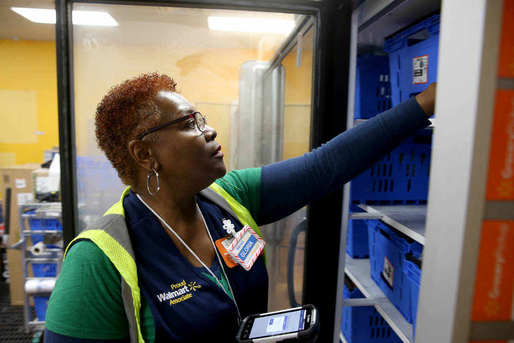 Personal shopper Gloria Mitchell prepares a customer merchandise pickup in a staging area at Wa ...